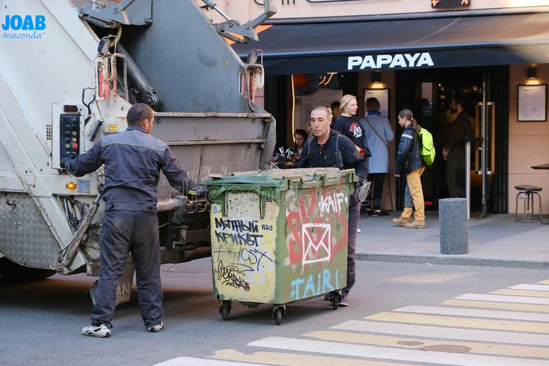 The workers of the garbage truck download garbage from street containers. Saint-Petersburg. Russia. 05.14.2019 royalty free stock photography
