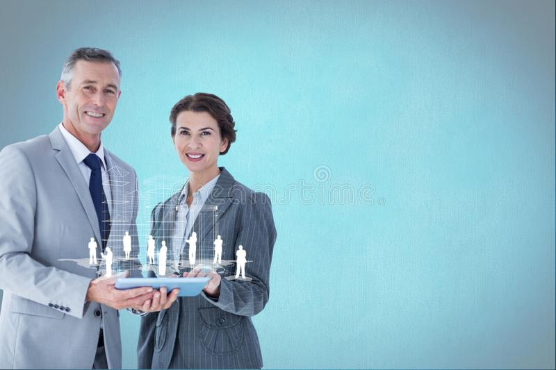 Workers holding tablet with digital persons. Digital composite of model with device connectors royalty free stock image