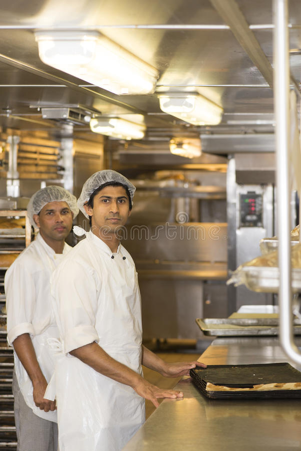 Free Workers In Restaurant Kitchen Stock Image - 44957851