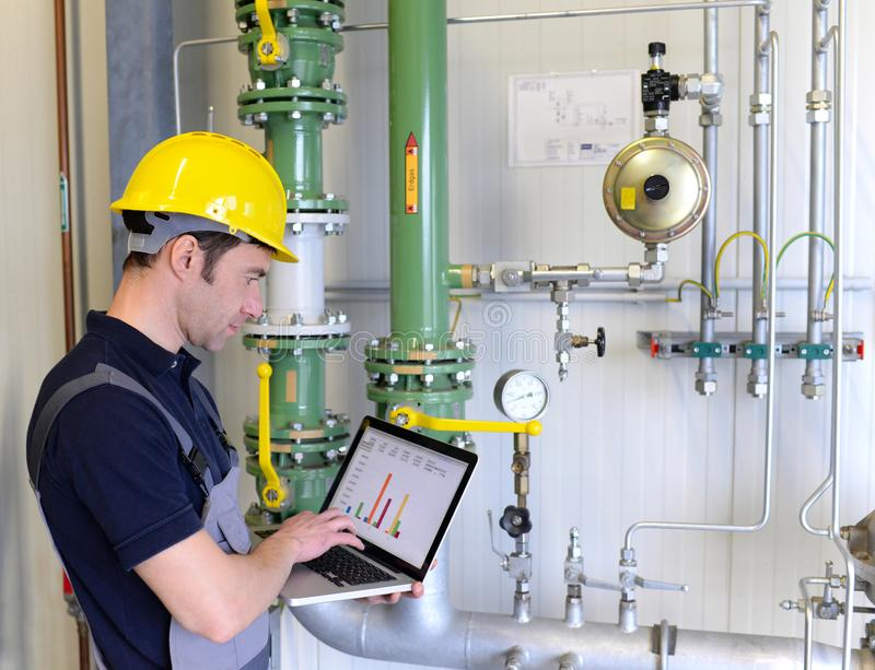 Workers in an industrial plant check the systems with modern technology stock photo