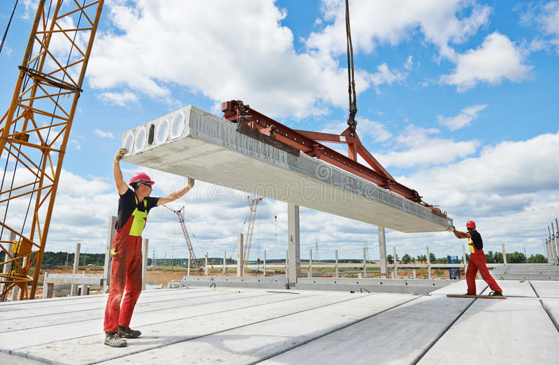 Workers installing concrete slab royalty free stock image