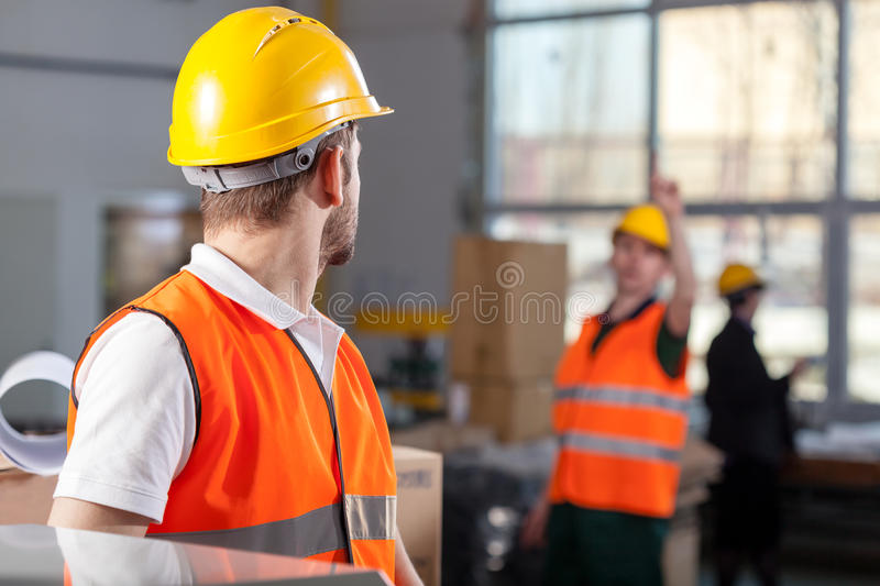 Workers during job in factory stock photo