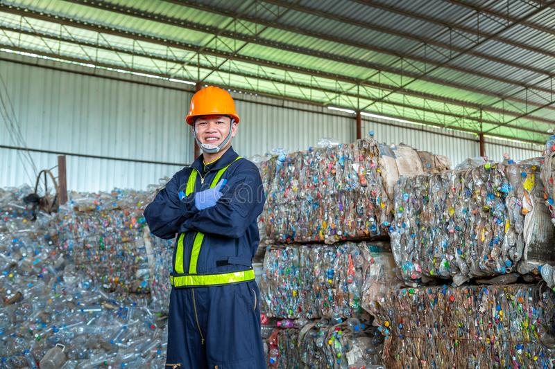 Workers in landfill dumping, Garbage engineer, recycling, wearing a safety suit standing in the recycling center have a plastic royalty free stock photography