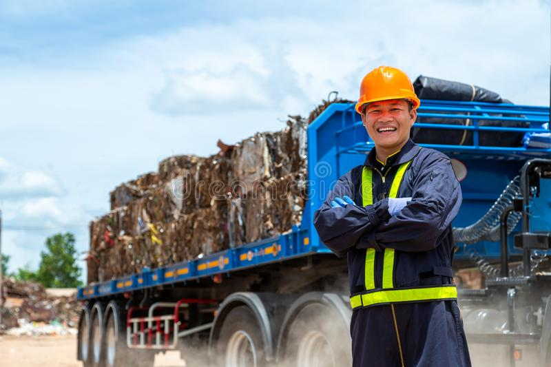 Workers in landfill dumping, Garbage engineer, recycling, wearing a safety suit Standing in front of the truck, the concept for royalty free stock photos
