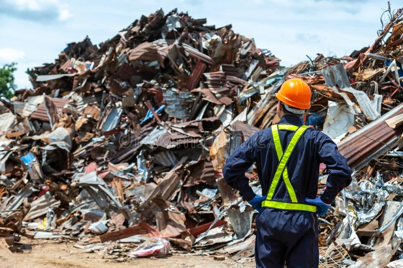 Workers in landfill dumping, Garbage engineer, recycling, wearing a safety suit standing in the outdoor recycling center have a royalty free stock photos