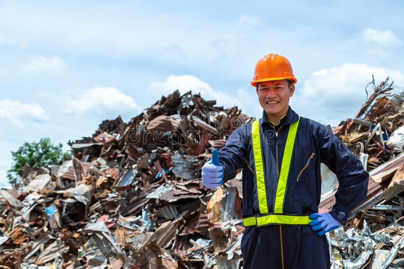 Workers in landfill dumping, Garbage engineer, recycling, wearing a safety suit standing in the outdoor recycling center have a royalty free stock photography
