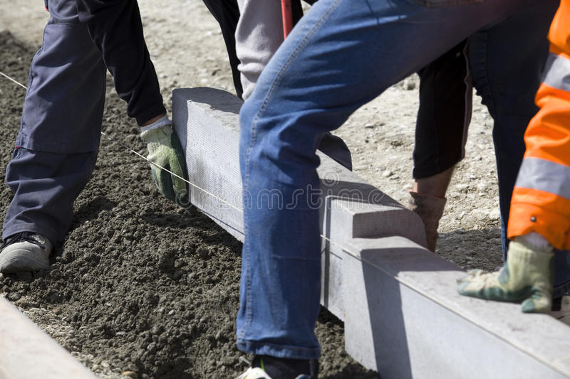 Workers laying breeze blocks royalty free stock image