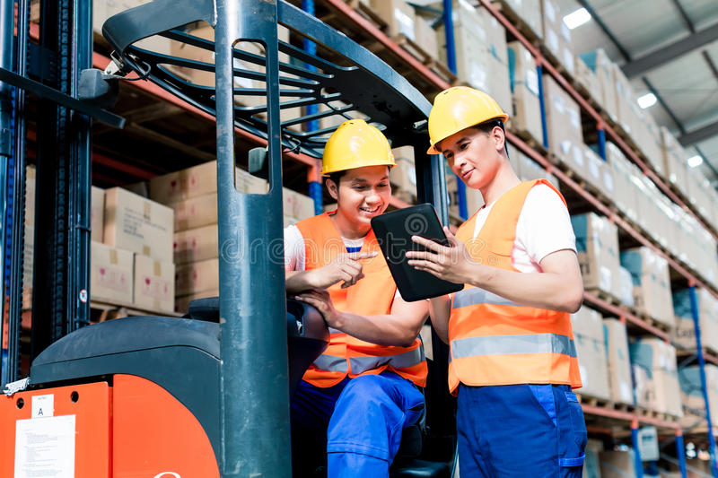 Workers in logistics warehouse royalty free stock photo