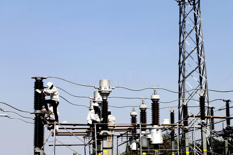 Workers maintenance sub station. Workers maintenance an electrical power sub station stock image