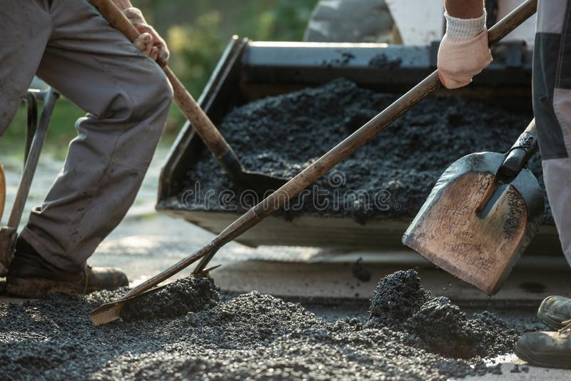 Workers making new asphalt pavement royalty free stock photography