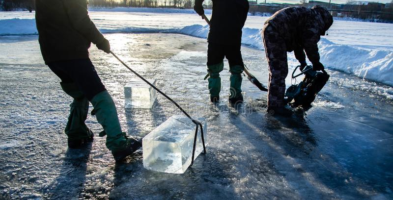 `Ice Miners` workers mine large cubes of natural river ice. Workers mine large cubes of natural river ice `Ice Miners stock photo