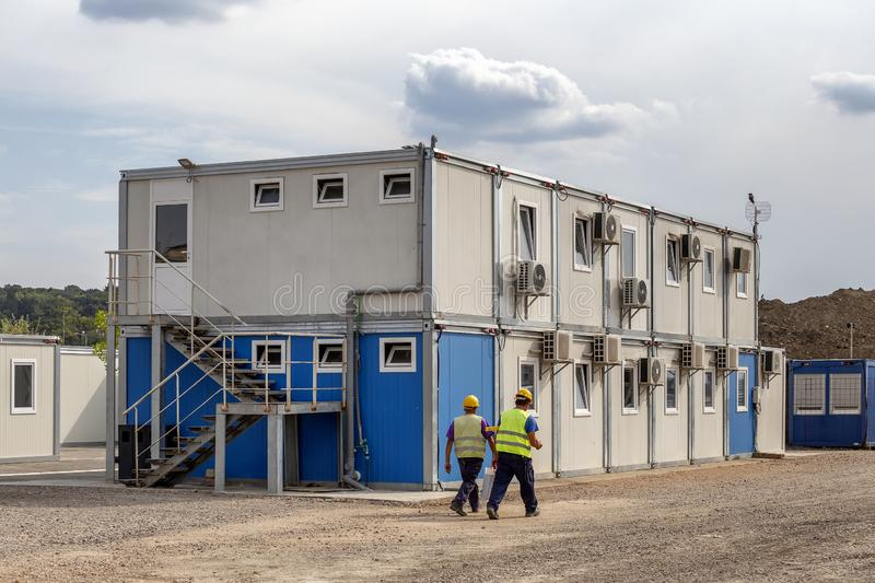 Workers at mobile containers and cabins base royalty free stock photography