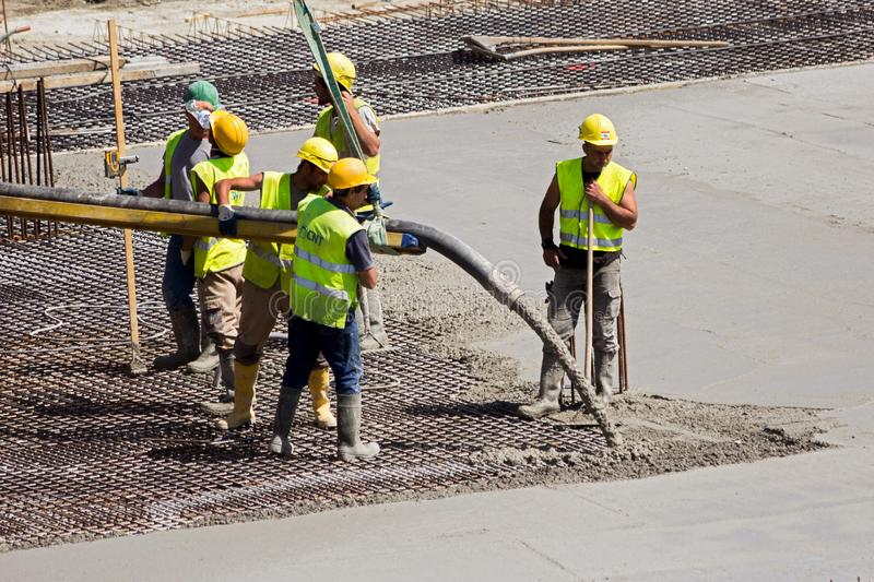 Workers pouring concrete construction site stock photo