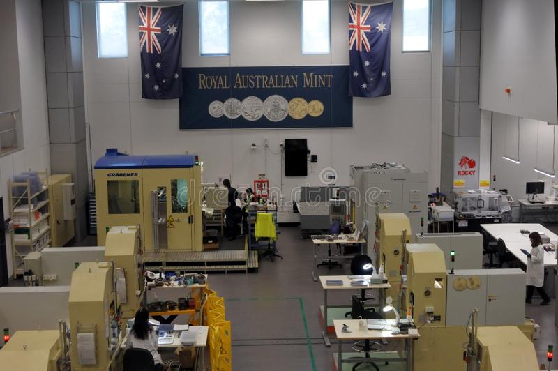 Workers in the process building of the Royal Australian Mint Canberra Australia. Workers in the process building of the Royal Australian Mint.The Royal royalty free stock images
