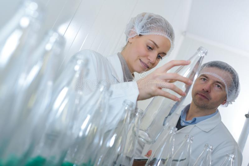 Workers at production line royalty free stock image