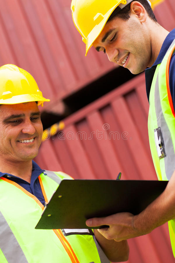 Download Workers Recording Containers Stock Photo - Image: 31710750