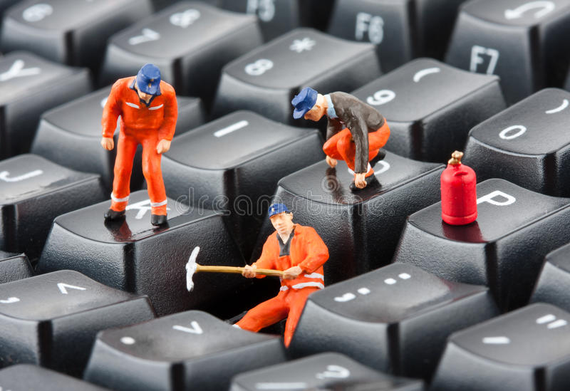 Workers repairing keyboard royalty free stock image