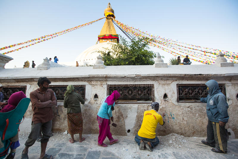 Workers repairing of Stupa Boudhanath, in Kathmandu, Nepal. stock photography