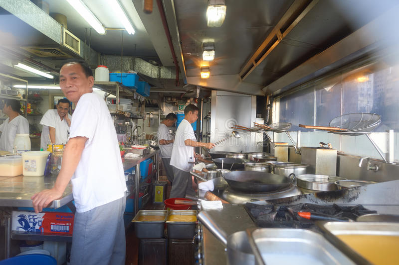 Workers at a restaurant in Kennedy Town. HONG KONG - OCTOBER 25, 2015: workers at a restaurant in Kennedy Town. Kennedy Town is at the western end of Sai Wan on royalty free stock images