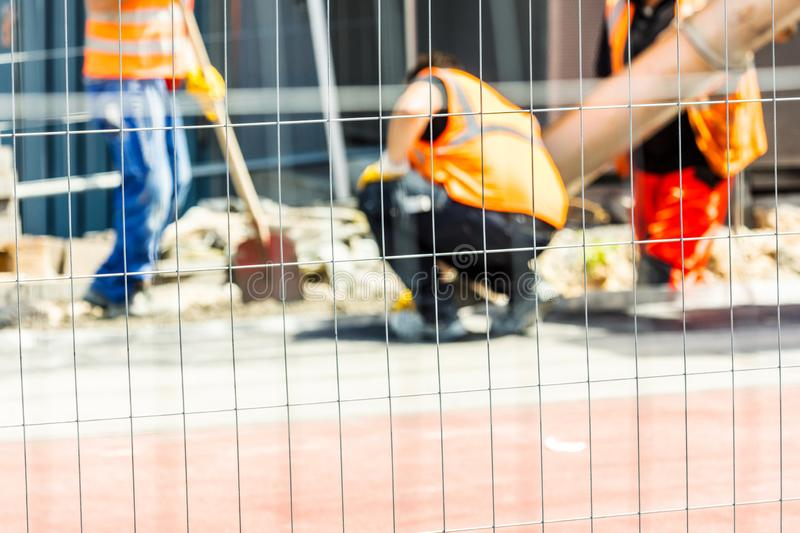 Workers on a road construction, industry and Teamwork work conzept royalty free stock photo