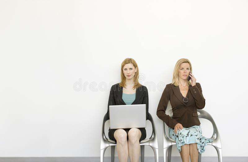 Workers sit in chairs royalty free stock photo
