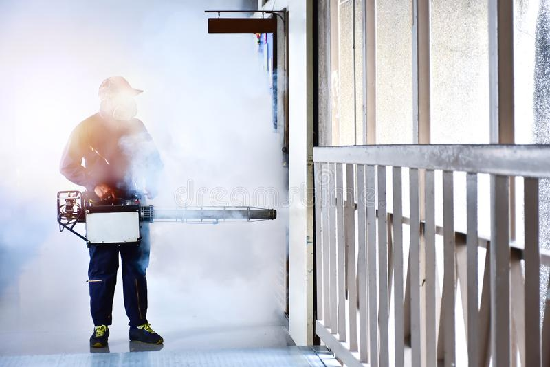 Workers are spraying get rid of mosquitoes stock image
