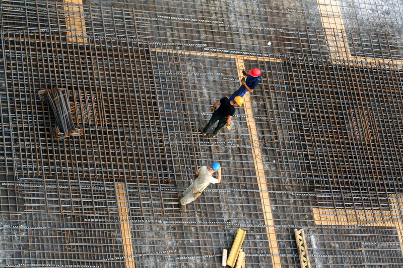 Workers on steel bars royalty free stock images