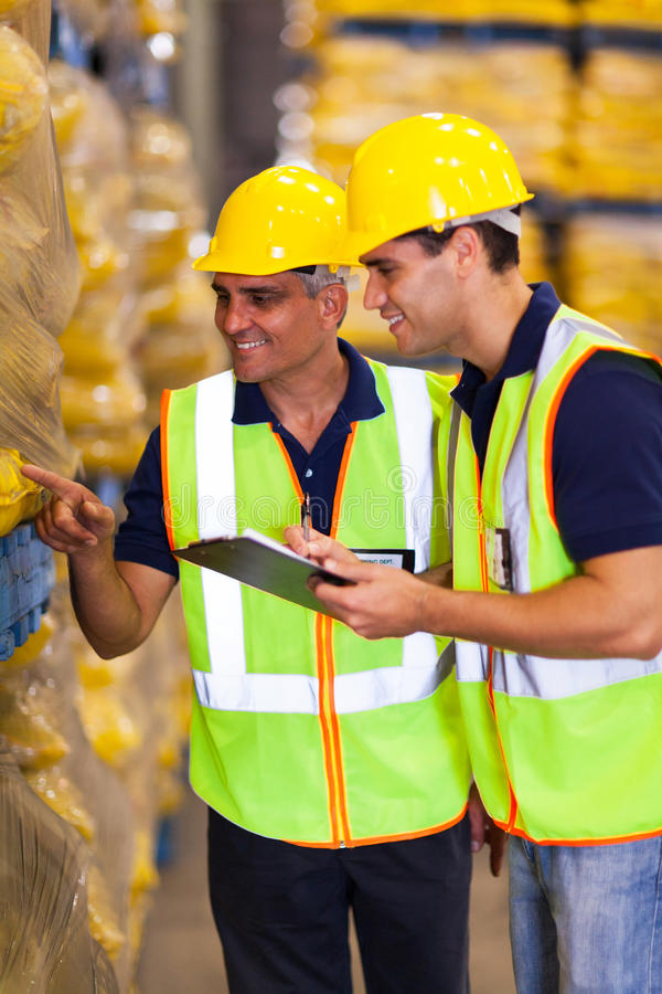 Workers stock take. Two warehouse workers doing stock take stock photography