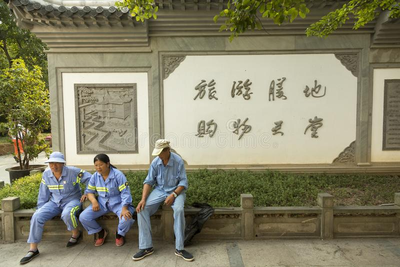 Workers taking rest in Shanghai, China. Workers taking break near Yu garden in Shanghai, China stock photo