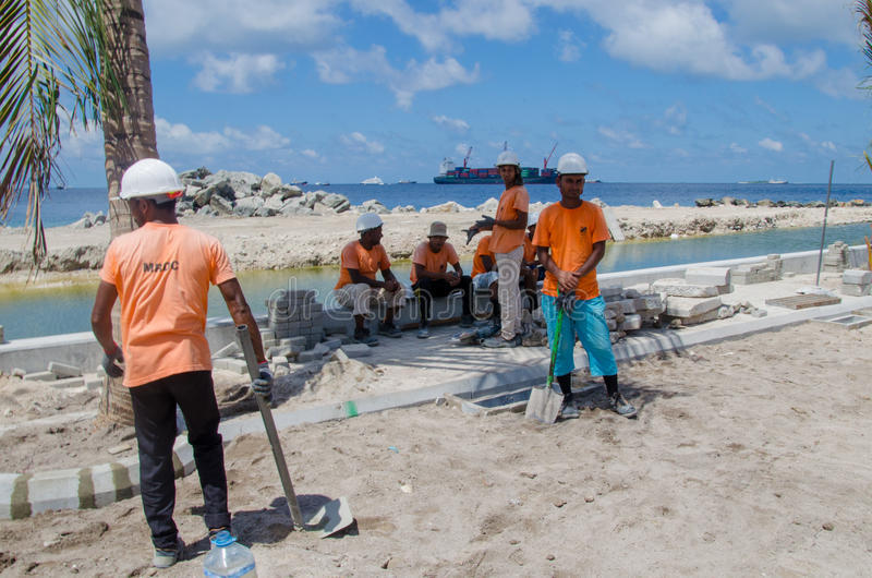 Workers taking rest in shadow. At construction site. Male.Maldives stock images
