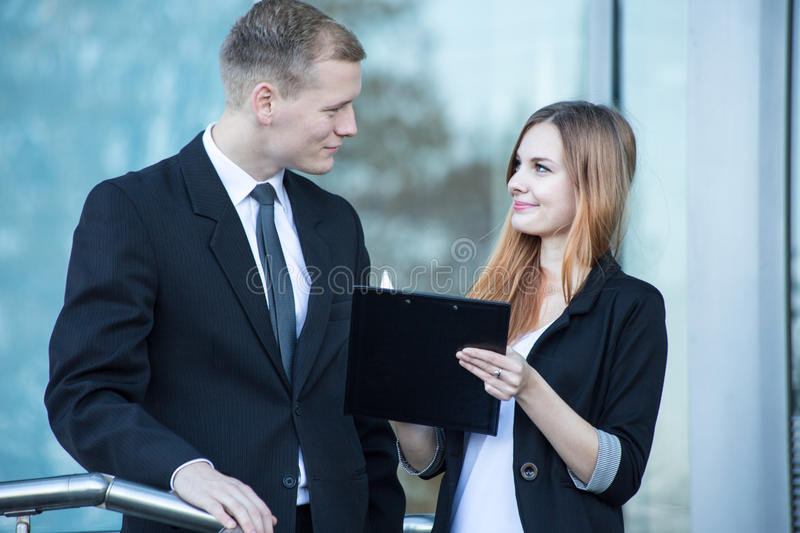 Workers talking about agreement stock photo