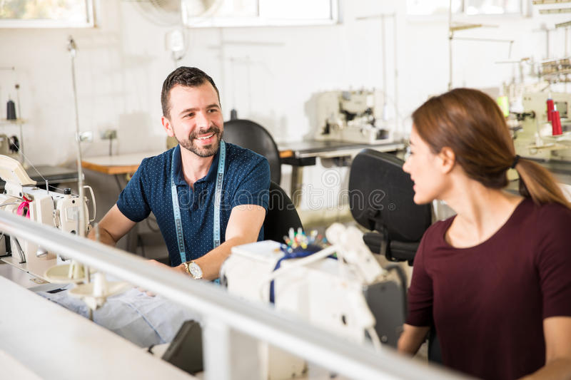 Workers talking in a textile factory royalty free stock images