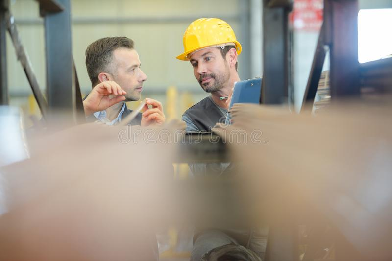 2 workers talking in warehouse royalty free stock images