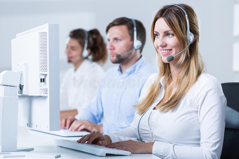 Workers of telemarketing service. Image of professional workers of telemarketing service royalty free stock photo