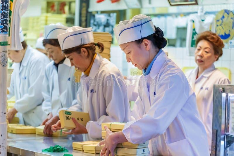 Workers at Tsukiji Market in Tokyo royalty free stock image