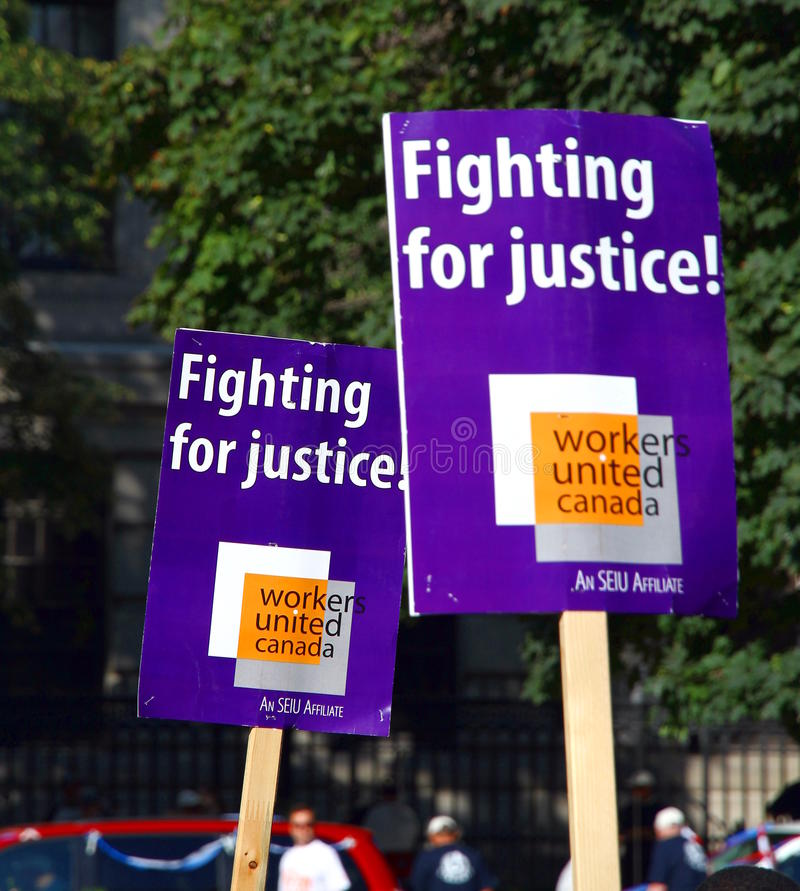 Download Workers United at a Parade editorial photography. Image of business - 26573067