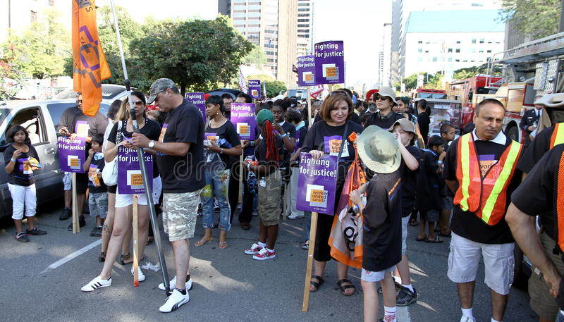 Download Workers United at a Parade editorial photography. Image of business - 26573137