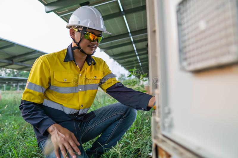 Workers use clamp meter to measure the current of electrical wires produced from solar energy for confirm to normal current.  royalty free stock photo