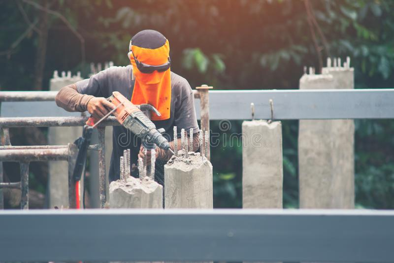 Workers are using Impact drill to drill concrete. royalty free stock photography