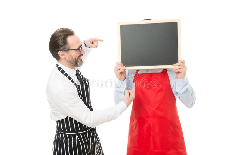 Workers wanted. Hipster bartender show blackboard copy space. Men bearded hipster informing you. Opening soon. Men royalty free stock photo