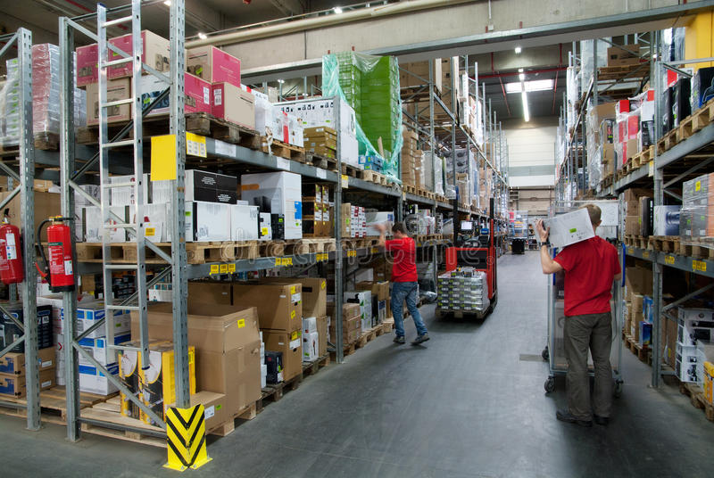 Workers in a warehouse royalty free stock photos