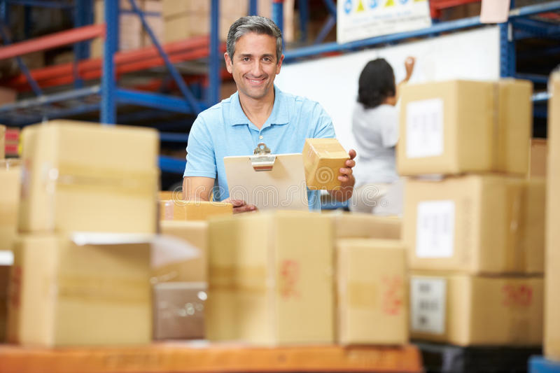Workers In Warehouse Preparing Goods For Dispatch royalty free stock images