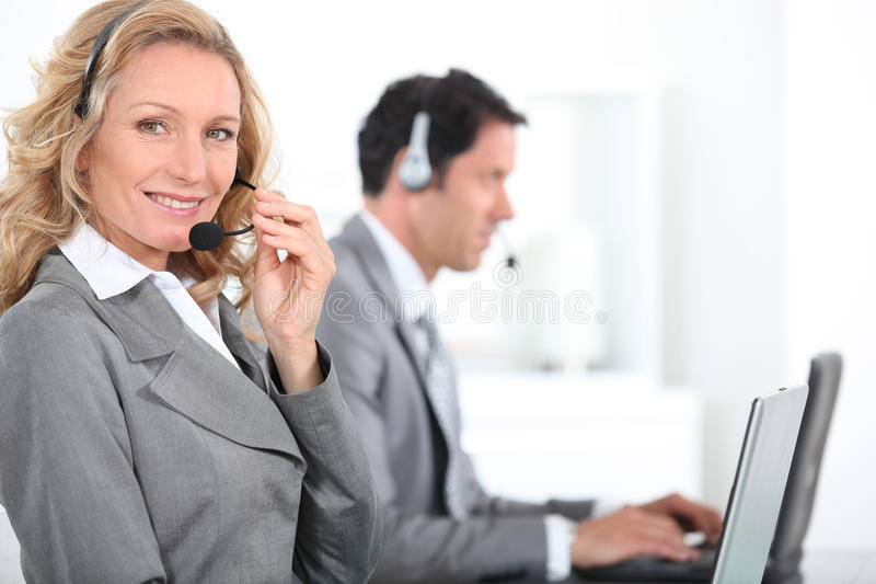 Workers wearing head-sets royalty free stock photo