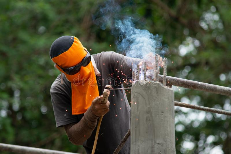 Workers are welding steel roof structure.  royalty free stock photos