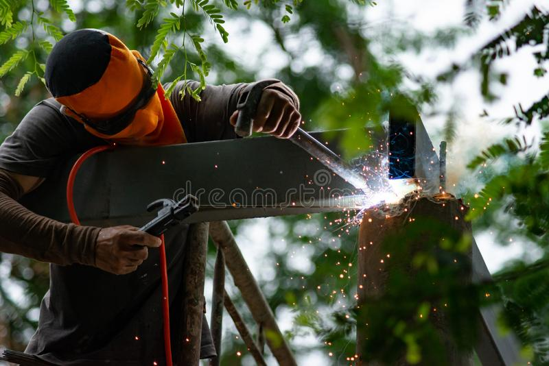 Workers are welding steel roof structure.  stock images