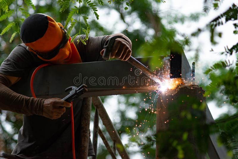 Workers are welding steel roof structure.  stock image
