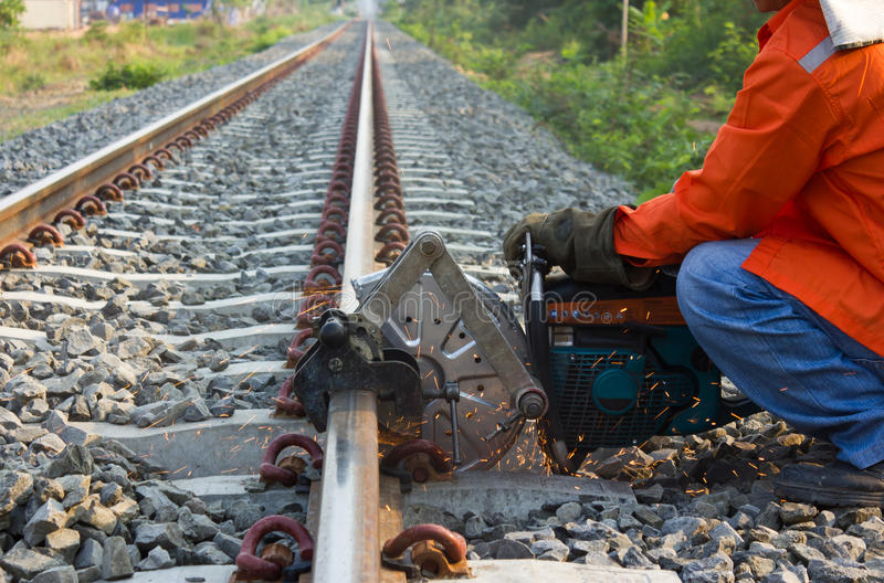Workers were cutting tracks . Workers were cutting tracks for maintenance royalty free stock image