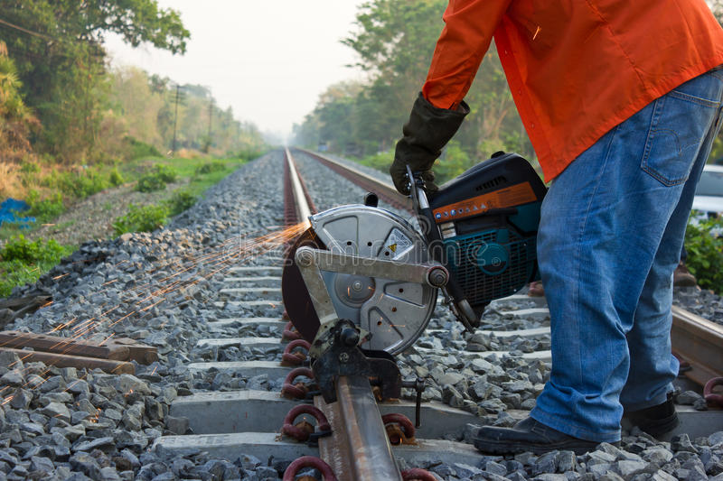 Workers were cutting tracks . Workers were cutting tracks for maintenance royalty free stock photos