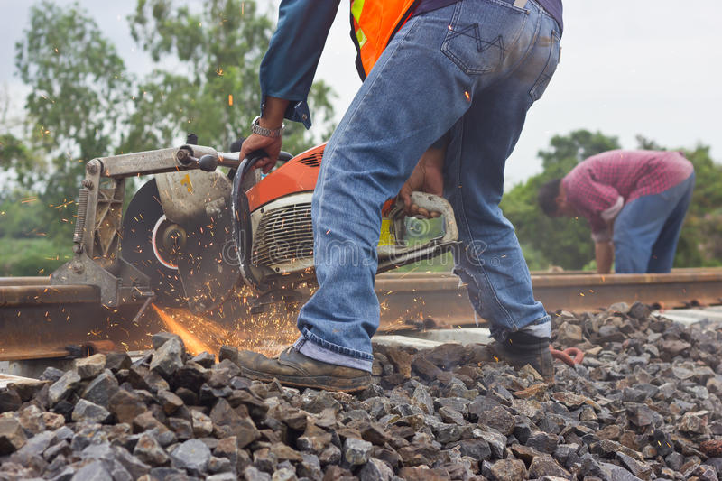 Workers were cutting tracks for maintenance. Workers were cutting tracks maintenance stock photo