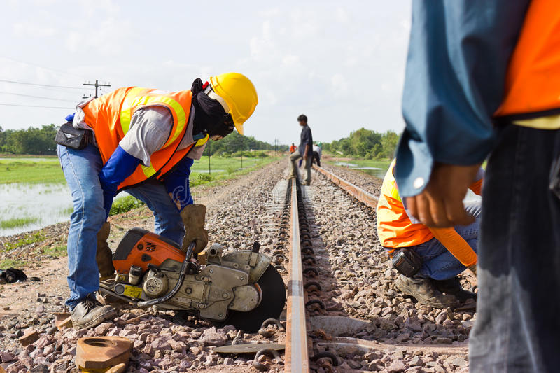 Workers were cutting tracks for maintenance. Workers were cutting tracks maintenance stock image